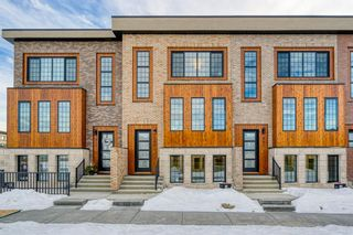 Photo 2: 309 81 Greenbriar Place NW in Calgary: Greenwood/Greenbriar Row/Townhouse for sale : MLS®# A1058995