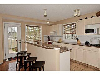 Photo 8: 254 TUSCANY VALLEY Drive NW in CALGARY: Tuscany Residential Detached Single Family for sale (Calgary)  : MLS®# C3569145