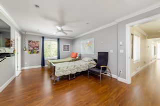 """Photo 23: 7464 149A Street in Surrey: East Newton House for sale in """"CHIMNEY HILLS"""" : MLS®# R2602309"""