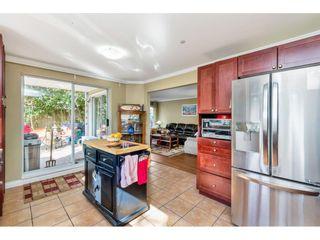 "Photo 9: 110 9650 148 Street in Surrey: Guildford Condo for sale in ""Hartford Woods"" (North Surrey)  : MLS®# R2447474"