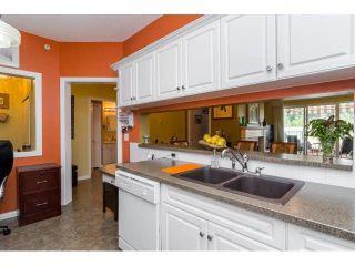 "Photo 8: 414 13860 70TH Avenue in Surrey: East Newton Condo for sale in ""Chelsea Gardens"" : MLS®# F1448214"