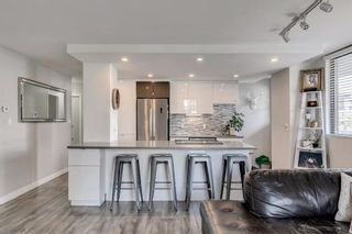 Photo 1: 401 215 14 Avenue SW in Calgary: Beltline Apartment for sale : MLS®# A1143280