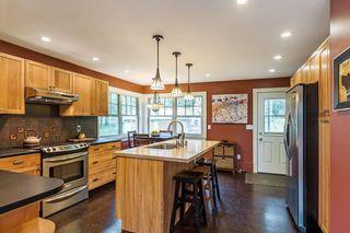 Photo 5: 26491 98 AVENUE in Maple Ridge: Thornhill MR House for sale : MLS®# R2230719