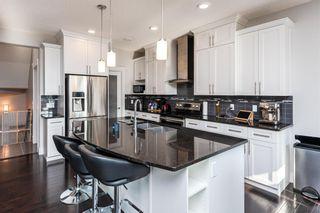 Photo 7: 711 179 Street in Edmonton: Zone 56 House for sale : MLS®# E4257489