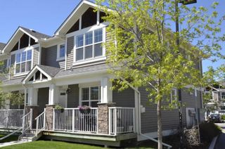 Photo 1: 203 Cranberry Park SE in Calgary: Cranston Row/Townhouse for sale : MLS®# A1111572