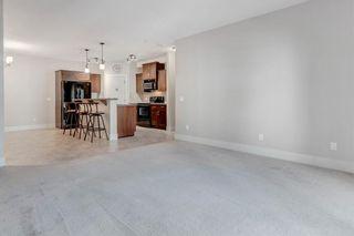 Photo 11: 306 77 George Fox Trail: Cochrane Apartment for sale : MLS®# A1139159