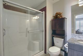 Photo 24: 2407 15 SUNSET Square: Cochrane Apartment for sale : MLS®# A1072593