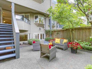 """Photo 1: 2411 W 1ST Avenue in Vancouver: Kitsilano Townhouse for sale in """"Bayside Manor"""" (Vancouver West)  : MLS®# R2191405"""