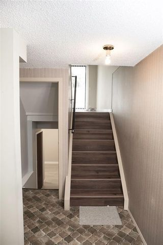 Photo 7: 1 10 POINT Drive NW in Calgary: Point McKay Row/Townhouse for sale : MLS®# A1089848