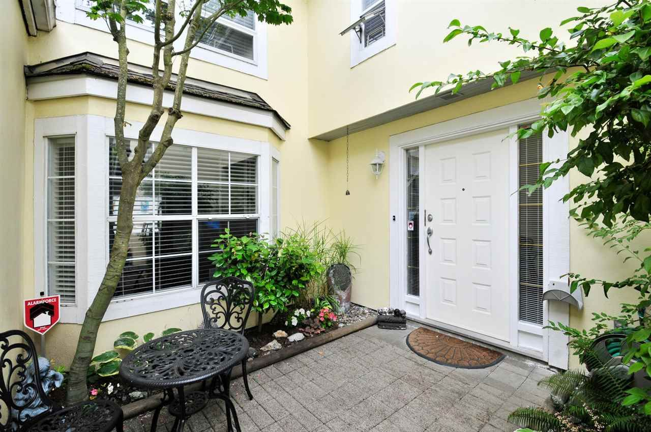 """Main Photo: 8469 PORTSIDE Court in Vancouver: Fraserview VE Townhouse for sale in """"RIVERSIDE TERRACE"""" (Vancouver East)  : MLS®# R2190962"""