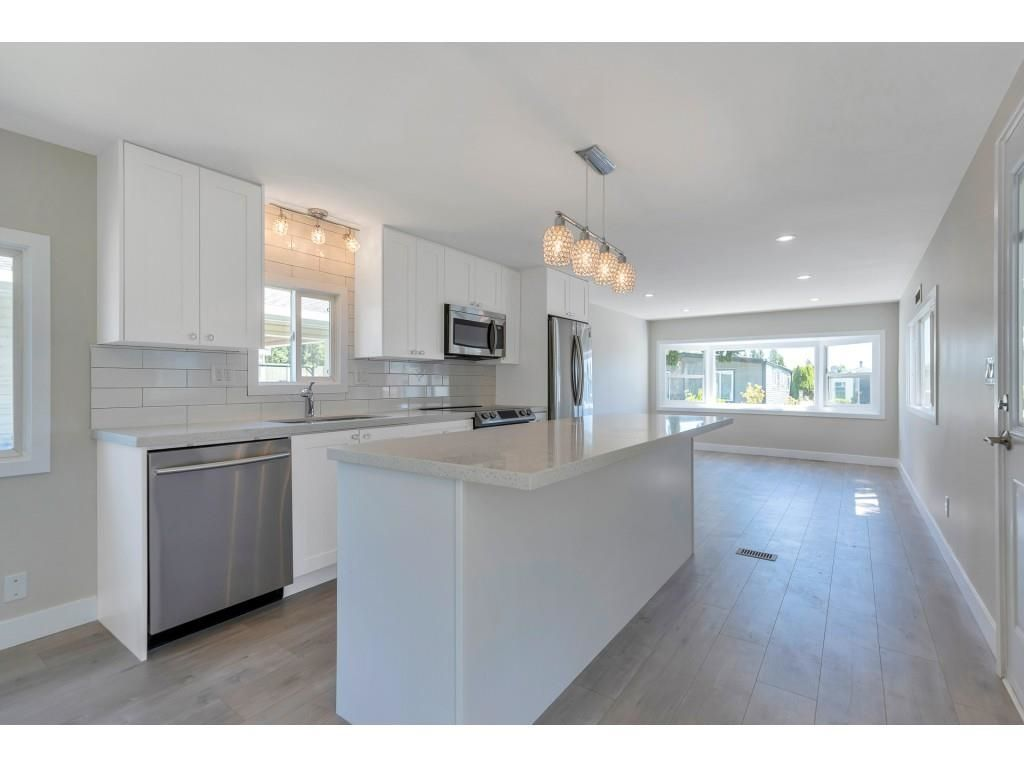 """Main Photo: 181 1840 160 Street in Surrey: King George Corridor Manufactured Home for sale in """"BREAKAWAY BAYS"""" (South Surrey White Rock)  : MLS®# R2585723"""