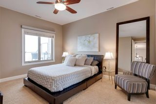 Photo 21: 34 Cougar Ridge Landing SW in Calgary: Cougar Ridge Row/Townhouse for sale : MLS®# A1075174