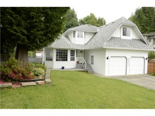 Photo 1: 8052 WAXBERRY CR in Mission: Mission BC House for sale : MLS®# F1413376