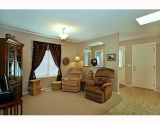 Photo 3: 579 STONEGATE Way NW: Airdrie Residential Attached for sale : MLS®# C3397152