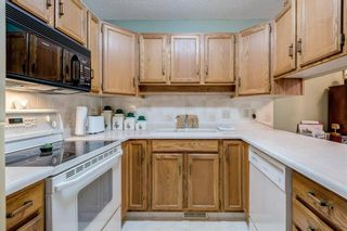 Photo 11: 71 Sandarac Circle NW in Calgary: Sandstone Valley Row/Townhouse for sale : MLS®# A1141051