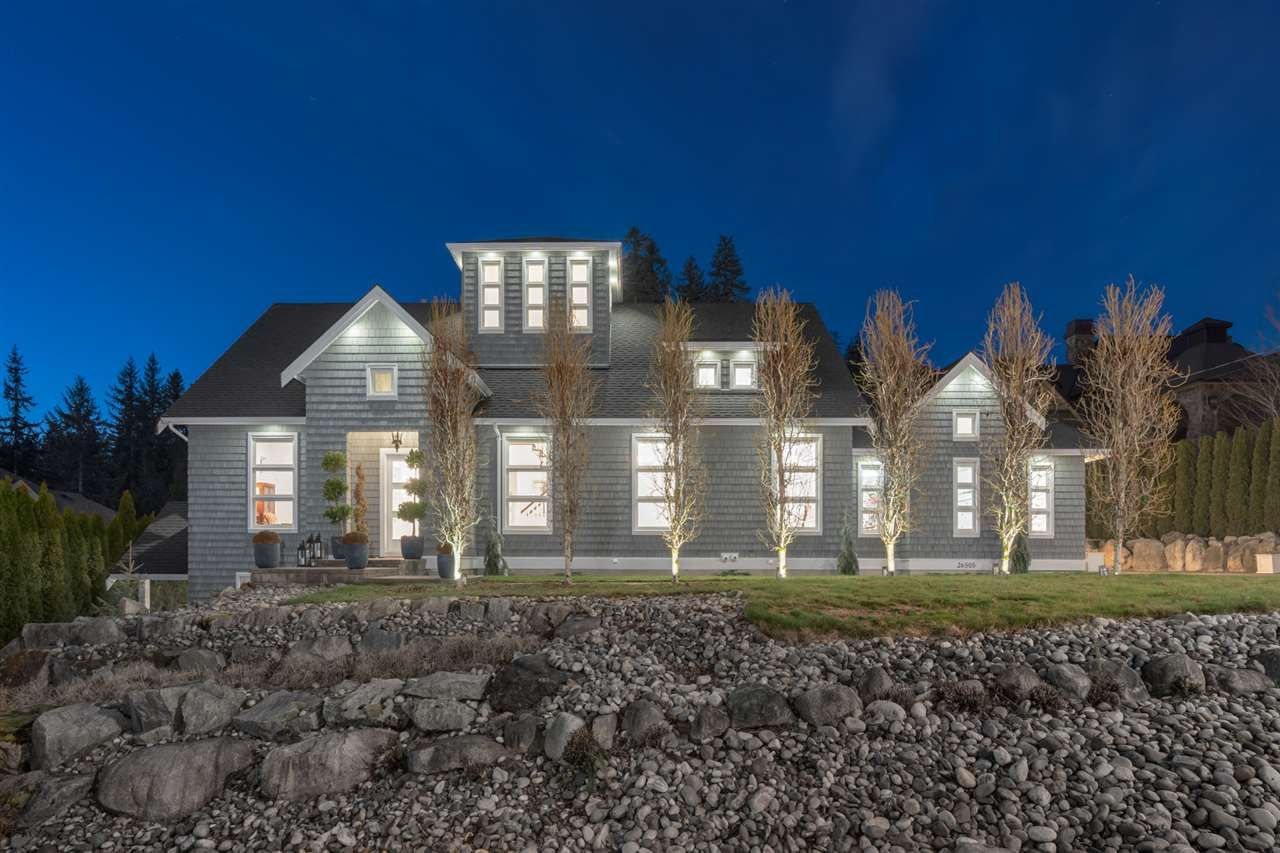 Custom built home backing on 1 acre in Whispering Heights