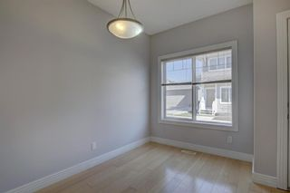 Photo 2: 76 Bridleridge Manor SW in Calgary: Bridlewood Row/Townhouse for sale : MLS®# A1106883