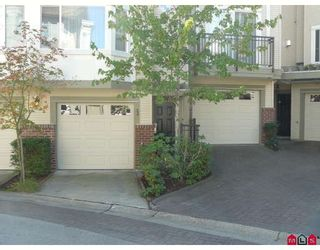 """Photo 1: 23 15450 101A Avenue in Surrey: Guildford Townhouse for sale in """"canterbury"""" (North Surrey)  : MLS®# F2920871"""