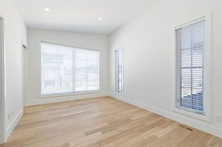 Photo 40: 7853 8a Avenue SW in Calgary: West Springs Detached for sale : MLS®# A1120136