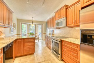 Photo 22: 20A Woodmeadow Close SW in Calgary: Woodlands Row/Townhouse for sale : MLS®# A1127050