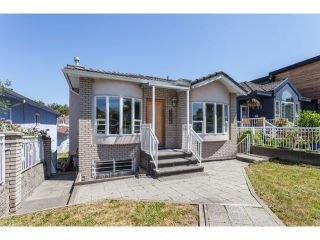 """Photo 1: 4766 KNIGHT Street in Vancouver: Knight House for sale in """"KNIGHT"""" (Vancouver East)  : MLS®# V1128909"""