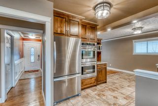Photo 8: 220 78 Avenue SE in Calgary: Fairview Detached for sale : MLS®# A1063435