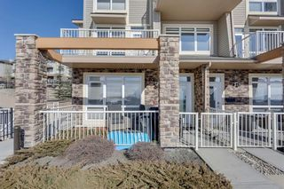 Main Photo: 1 145 ROCKYLEDGE View NW in Calgary: Rocky Ridge Row/Townhouse for sale : MLS®# A1130971