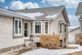 Photo 4: 210 Arbour Cliff Close NW in Calgary: Arbour Lake Semi Detached for sale : MLS®# A1086025