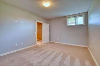 Photo 41: 64 RIVER HEIGHTS View: Cochrane Semi Detached for sale : MLS®# C4300497