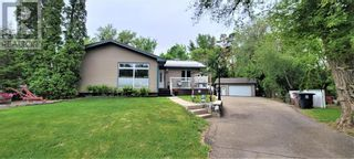 Photo 1: 32  Purcell Place E in Brooks: House for sale : MLS®# A1065831
