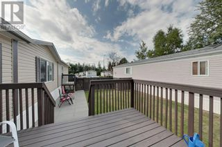Photo 2: 38, 812 6 Avenue SW in Slave Lake: House for sale : MLS®# A1140933
