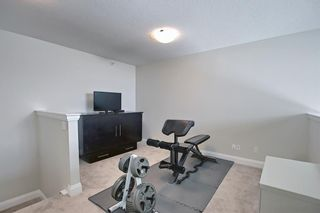 Photo 27: 2407 15 SUNSET Square: Cochrane Apartment for sale : MLS®# A1072593