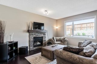 Photo 11: 205 Heritage Boulevard: Cochrane Detached for sale : MLS®# A1122442