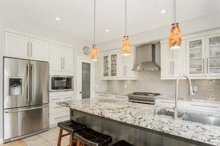 Photo 12: 647 Oakdale Drive in Winnipeg: Charleswood Residential for sale (1G)  : MLS®# 202113883