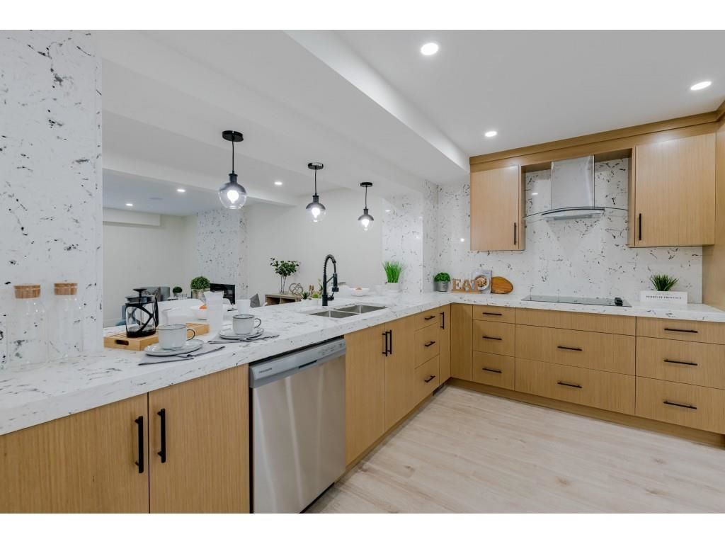 """Main Photo: 8151 FOREST GROVE Drive in Burnaby: Forest Hills BN Townhouse for sale in """"WEMBLEY ESTATES"""" (Burnaby North)  : MLS®# R2618074"""
