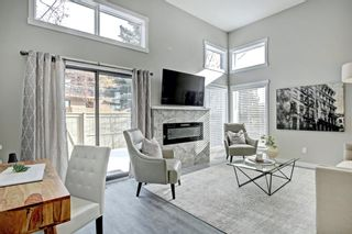Photo 2: 14 Glamis Gardens SW in Calgary: Glamorgan Row/Townhouse for sale : MLS®# A1076786