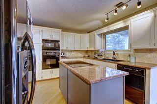 Photo 10: 505 Suntree Place: Okotoks Detached for sale : MLS®# A1110721