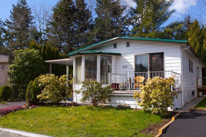 "Main Photo: 330 1840 160 Street in Surrey: King George Corridor Manufactured Home for sale in ""Breakaway  Bays"" (South Surrey White Rock)  : MLS®# R2250329"
