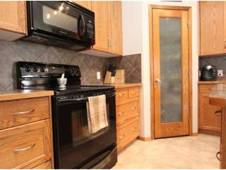 Photo 8: 779 STONEHAVEN Drive: Carstairs Residential Detached Single Family for sale : MLS®# C3617481