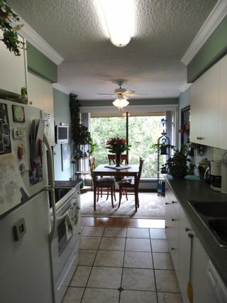 Photo 2: 311 7055 WILMA STREET in The Beresford: Highgate Home for sale ()