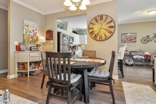 Photo 4: 101 20281 53A Avenue in Langley: Langley City Condo for sale : MLS®# R2444359
