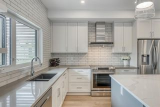Photo 15: 98 23 Street NW in Calgary: West Hillhurst Row/Townhouse for sale : MLS®# A1066637