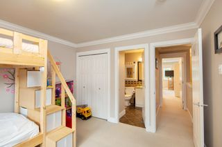 """Photo 18: 101 3333 DEWDNEY TRUNK Road in Port Moody: Port Moody Centre Townhouse for sale in """"CENTREPOINT"""" : MLS®# R2378597"""