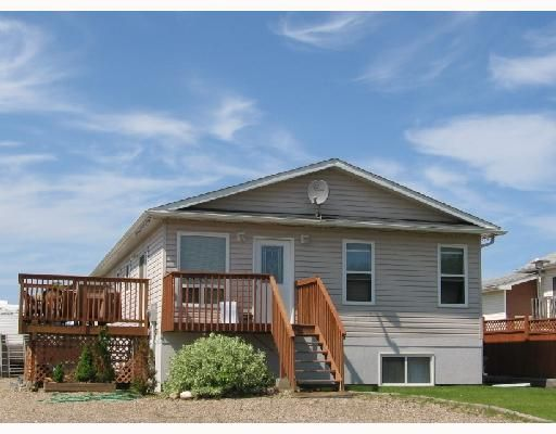 """Main Photo: 4453 HERITAGE Crescent in Fort_Nelson: Fort Nelson -Town House for sale in """"MIDTOWN"""" (Fort Nelson (Zone 64))  : MLS®# N184458"""