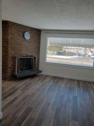 Photo 3: 405 MILLBOURNE Road E in Edmonton: Zone 29 House Half Duplex for sale : MLS®# E4238189