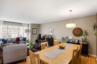 Photo 12: 69 Tuscany Springs Gardens NW in Calgary: Tuscany Row/Townhouse for sale : MLS®# A1112566