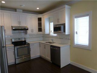 Photo 3: 2053 E 1ST Avenue in Vancouver: Grandview VE 1/2 Duplex for sale (Vancouver East)  : MLS®# V1078049