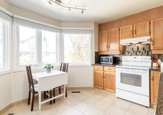 Photo 11: 19 Coachway Green SW in Calgary: Coach Hill Row/Townhouse for sale : MLS®# A1144999