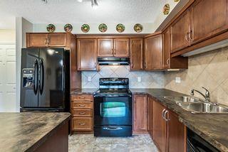Photo 8: 3209 200 Community Way: Okotoks Apartment for sale : MLS®# A1132297