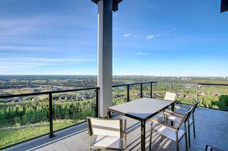 Photo 3: 42 Coulee Lane SW in Calgary: Cougar Ridge Detached for sale : MLS®# A1042251